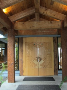 carved yellow cedar doors to enter the Wickannish Inn